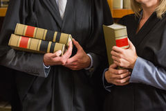 Lawyers holding books in the law library Royalty Free Stock Photos