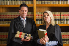 Lawyers holding books in the law library Stock Image
