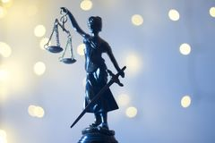 Lawyers justice legal office statue. Lawyers legal office law statue representing blind justice courts figure with scales and sword stock image
