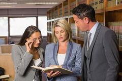 Lawyers in the law library Stock Images