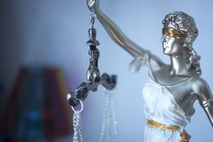 Lawyers legal justice statue. Lawyers legal blind justice bronze statue Themis and scales in attorneys law firm offices Royalty Free Stock Image
