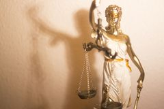 Lawyers legal justice statue. Lawyers legal blind justice bronze statue Themis and scales in attorneys law firm offices Stock Photography