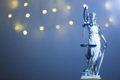 Lawyers justice legal office statue. Lawyers legal office law statue representing blind justice courts figure with scales and sword royalty free stock photography