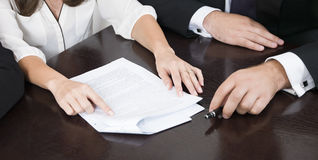Lawyers preparing a case. Couple of lawyers preparing a case Royalty Free Stock Image