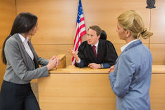 Lawyers speaking with the judge stock photos