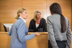Lawyers speaking with the judge Stock Image