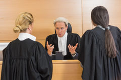 Lawyers speaking with the judge Stock Photography