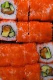 lax- och kaviarsushibakgrund material rått hav för läcker ny japan för fiskmat japansk citron Sushimeny Royaltyfri Bild