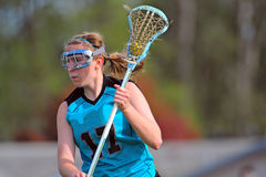 LAX player with the ball 2. High School Girls lacrosse player looking for a chance to check Royalty Free Stock Images