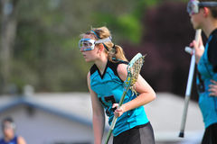 LAX player with the ball. High School Girls lacrosse player looking for a chance to check Stock Image