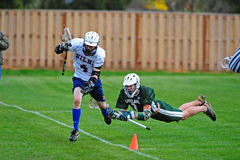 LAX player falling Royalty Free Stock Image