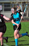 LAX player protecting the ball Royalty Free Stock Image