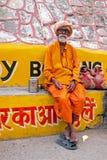 LAXMAN JHULA, INDIA - APRIL 19, 2017: A Hindu sadhu sitting in the streets from Laxman Jhula India Royalty Free Stock Image