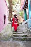 LAXMAN JHULA, INDIA - APRIL 20, 2017: A Hindu sadhu walking in the streets from Laxman Jhula India Stock Photography