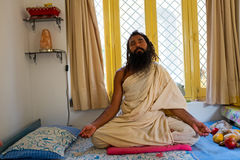 LAXMAN JHULA, INDIA - APRIL 20, 2017: A Hindu swami sitting in meditation in India Royalty Free Stock Photo