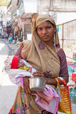 LAXMAN JHULA, INDIA - APRIL 15, 2017: Indian woman with newborn. Baby in the streets of Laxman Jhula in India Stock Photo