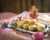 Laxmi and sweet Stock Photography