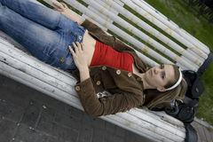 Lay on bench. Girl lying on the bench Stock Photography