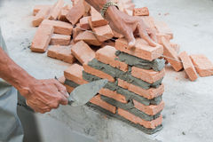 Lay bricks stock images