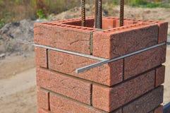 Lay bricks and blocks correctly. Closeup. Royalty Free Stock Photo