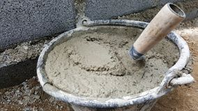 Lay bricks with cement mixing tub, mortar concrete. This is lay bricks with cement mixing tub, mortar concrete royalty free stock image