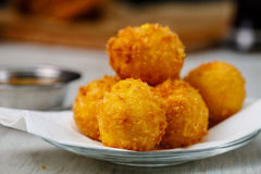 Lay the croquettes on a plate with red sauce. Royalty Free Stock Photography