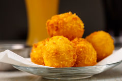 Lay the croquettes on a plate with red sauce. Stock Images