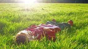 Lay down in grass Stock Images