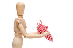Lay figure is giving a red checkered heart Stock Photo