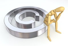 Lay Figure Sitting on Copyright Symbol. Lay figure sitting on silver/chrome copyright symbol Royalty Free Stock Photography