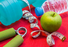 Free Lay Flat - Dumbbell, Measuring Tape, Hand Grip, Mineral Water, F Royalty Free Stock Photo - 96956985