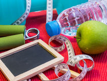 Lay Flat - Dumbbell, Measuring Tape, Hand Grip, Mineral Water, F Royalty Free Stock Photos