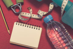 Lay Flat - Dumbbell, Measuring Tape, Hand Grip, Mineral Water, F Royalty Free Stock Photography