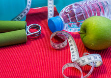 Lay Flat - Dumbbell, Measuring Tape, Hand Grip, Mineral Water, F Stock Photo