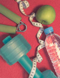 Lay Flat - Dumbbell, Measuring Tape, Hand Grip, Mineral Water, F Royalty Free Stock Image