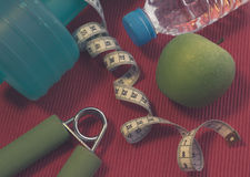 Lay Flat - Dumbbell, Measuring Tape, Hand Grip, Mineral Water, F Stock Image