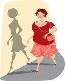 Overweight Lady and Her Shadow Royalty Free Stock Photo