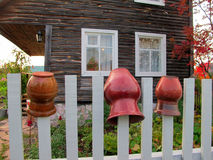 Сlay pots on the fence Royalty Free Stock Photo