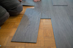 Lay vinyl floor on parquet floor Stock Photos