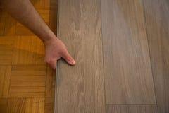 Lay vinyl floor on parquet floor. Wood Royalty Free Stock Image