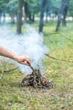Lay the wood on the fire, a fire in the forest Royalty Free Stock Photos
