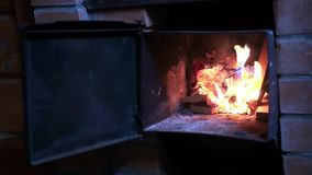 Lay the wooden logs in the oven, foment that would warm up, Slow motion. 1920x1080 stock footage