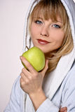Layd eating Apple. Girl Easting Green and Fresh Apple Royalty Free Stock Photo
