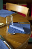 Layed table with paper napkins Royalty Free Stock Photography