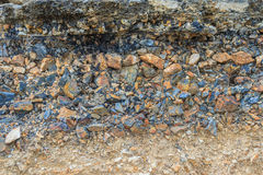 The layer of asphalt road with soil and rock after landslide. Royalty Free Stock Photo