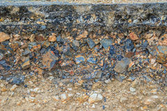 The layer of asphalt road with soil and rock after landslide. Royalty Free Stock Photography