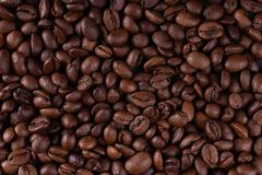 A layer of black roasted coffee stock photo