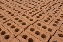 Layer of bricks. Layer of packed bricks ready for used at a construction site royalty free stock photography
