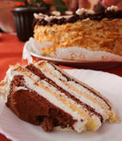 Sweet sin. Slice of layer cake on a white plate royalty free stock photography