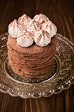Layer cake with cocoa and meringue close-up Stock Photos
